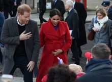 Britain's Prince Harry, Duke of Sussex (L) and Meghan, Duchess of Sussex greet wellwishers as they visit Birkenhead, northwest England on January 14, 2019. (Photo by PAUL ELLIS / AFP)